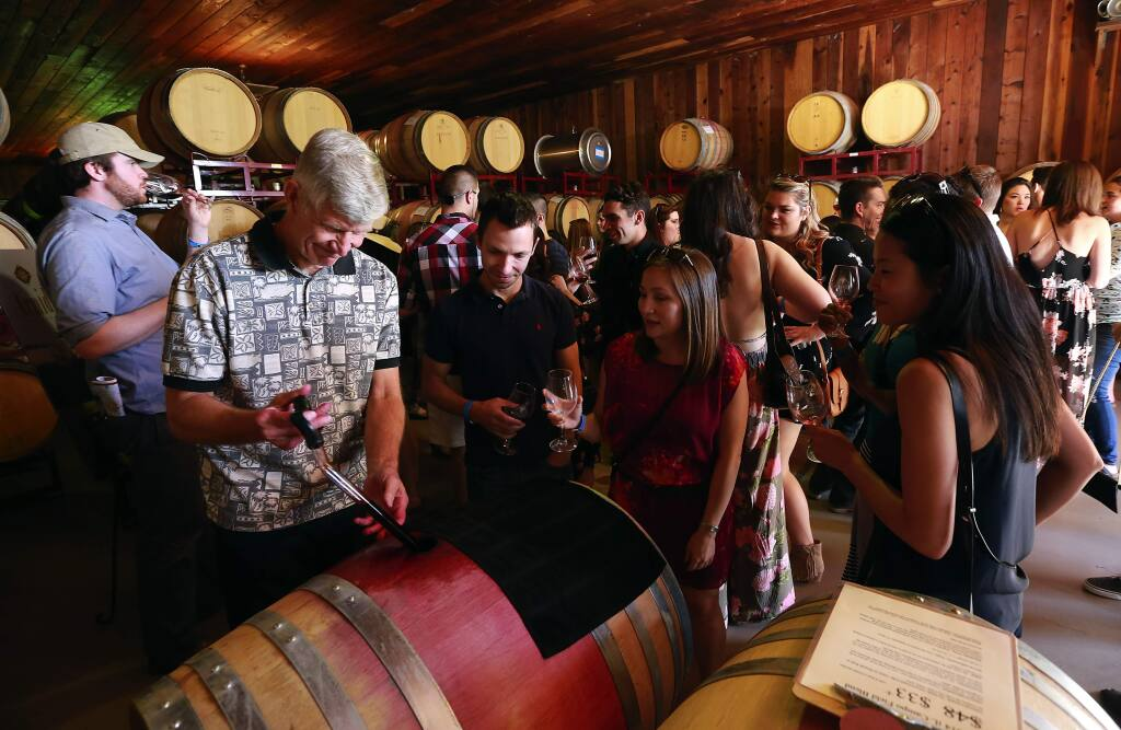 Wine lovers attend the 37th Annual Wine Road Barrel Tasting in 2015. Sonoma County planning officials have named winery executives, environmentalists and several rural residents to a panel charged with crafting proposed regulations that could set new standards for winery development and events. (John Burgess/ Press Democrat, 2015)