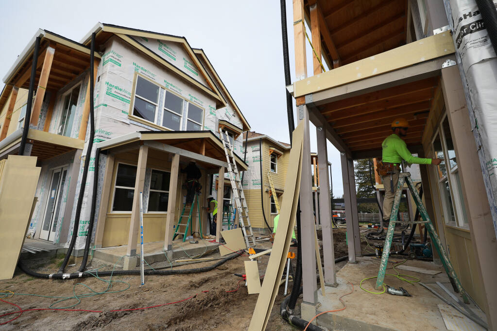 Construction crews work at the Windsor Veterans Village in Windsor on Tuesday, Feb. 9, 2021. The project includes 60 affordable housing units for low-income veterans and their families. (Christopher Chung / The Press Democrat)