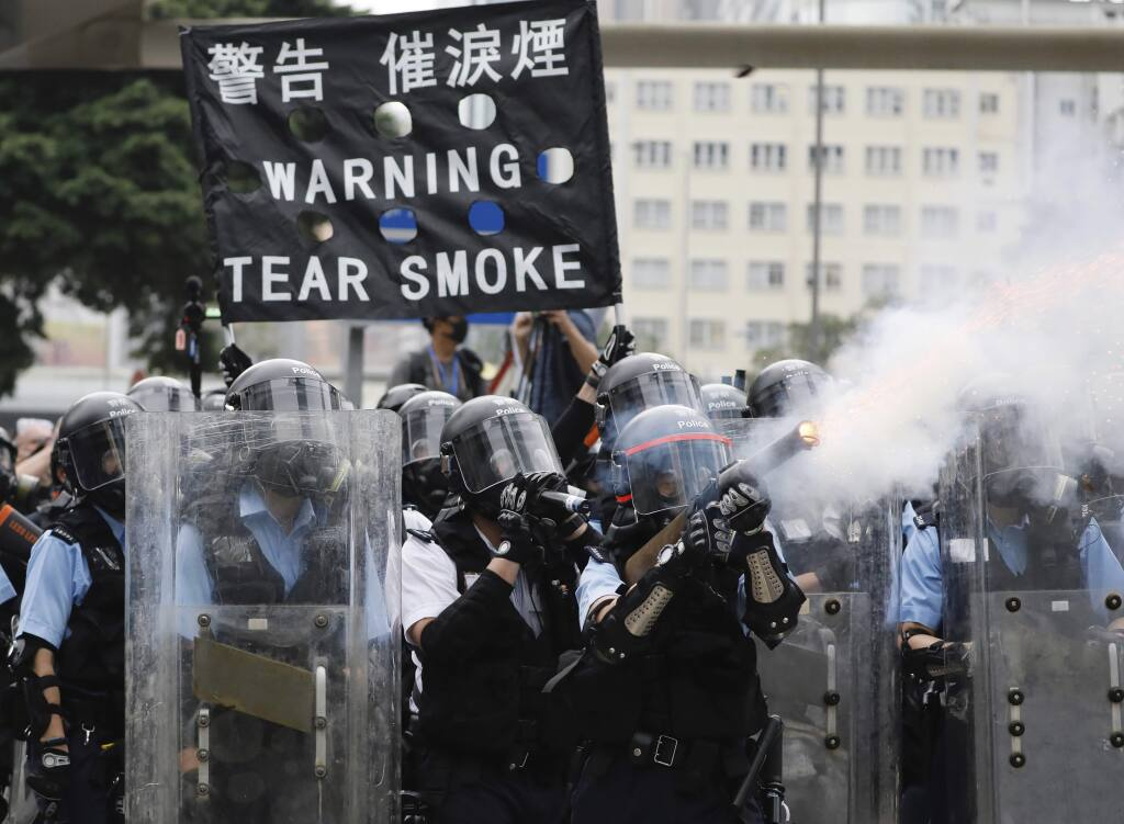 Police fire tear gas towards protesters outside the Legislative Council in Hong Kong, Wednesday, June 12, 2019. Hong Kong police used tear gas and high-pressure water hoses against protesters who had massed outside government headquarters Wednesday in opposition to a proposed extradition bill that has become a lightning rod for concerns over greater Chinese control and erosion of civil liberties in the semiautonomous territory. (AP Photo/Vincent Yu)