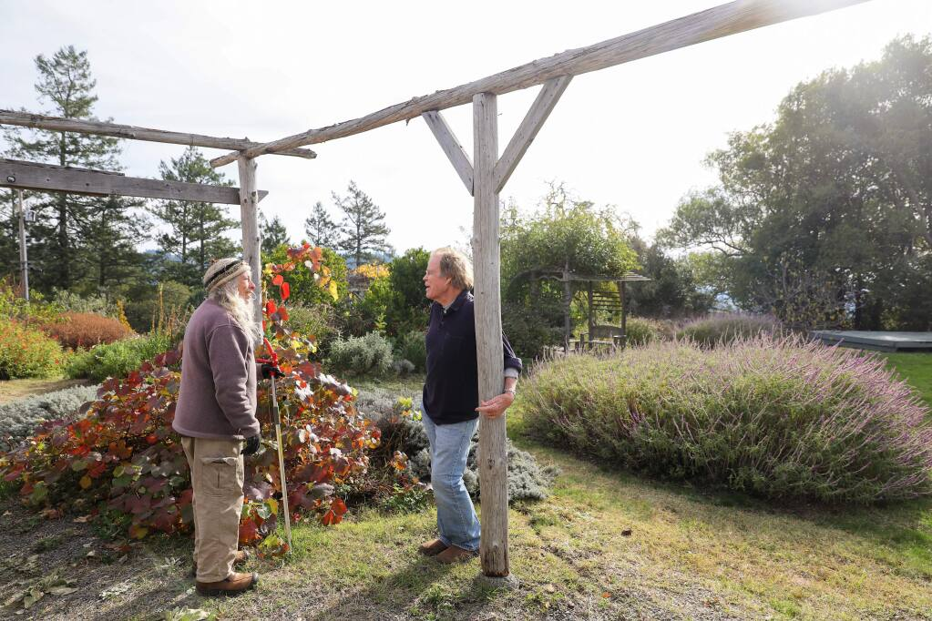 Karen Vogel, left, talks with Pieter Myers at the Ocean Song property, off of Coleman Valley Road, in west Sonoma County, on Tuesday, December 17, 2019. (Christopher Chung/ The Press Democrat)