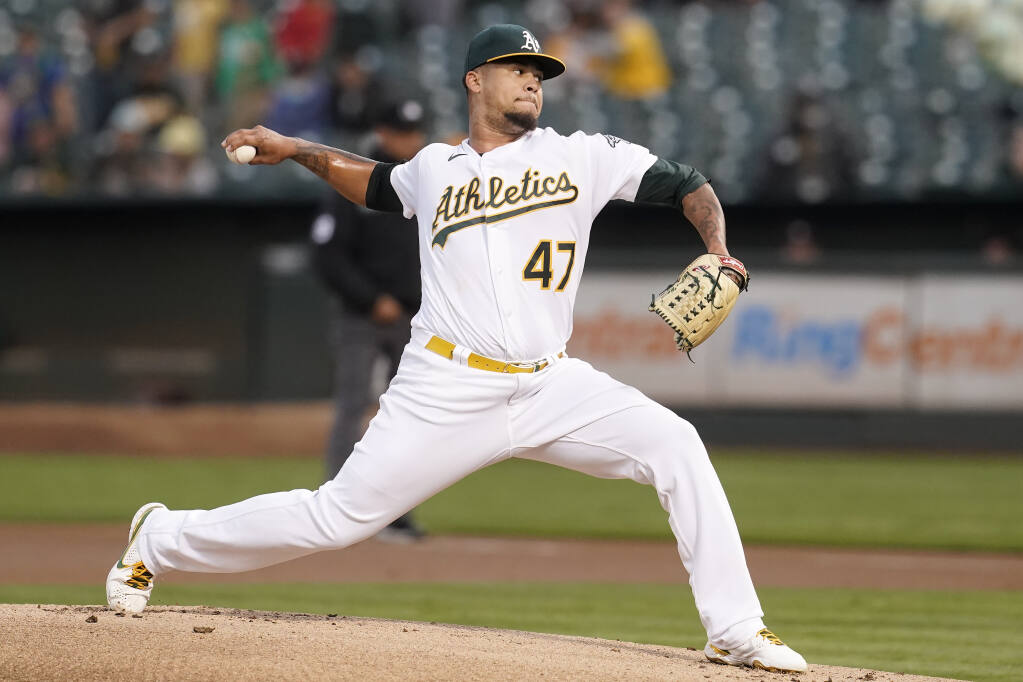 The Oakland Athletics' Frankie Montas pitches against the Houston Astros during the first inning in Oakland on Friday, Sept. 24, 2021. (Jeff Chiu / ASSOCIATED PRESS)