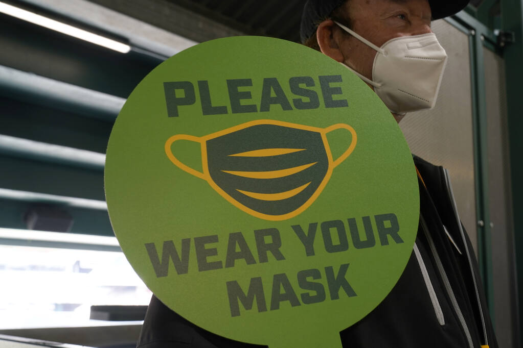 The latest recommendations from Santa Barbara, Monterey, Napa, San Benito, Santa Cruz and Ventura raise to 17 the number of counties now asking even fully vaccinated individuals to wear face coverings as a precaution while inside places like grocery stores, movie theaters and retail outlets. (AP Photo/Jeff Chiu, File)