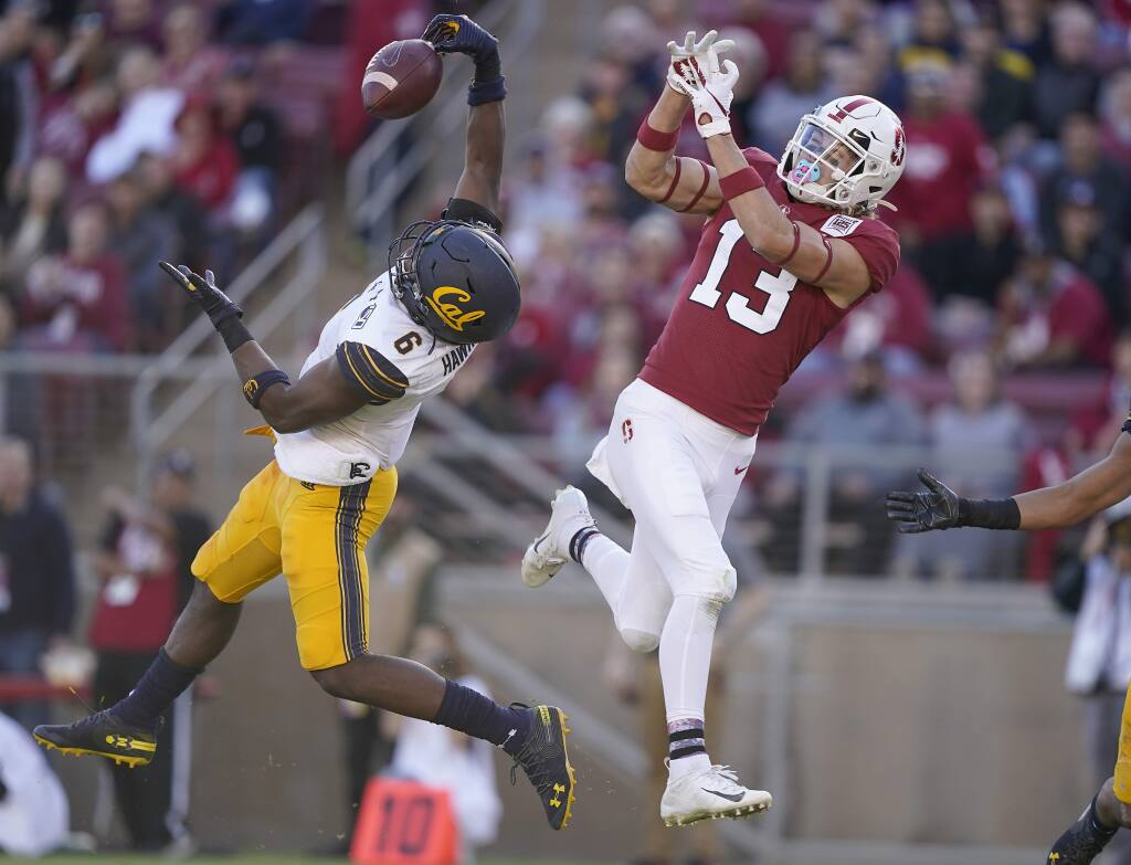 Cal safety Jaylinn Hawkins (6) intercepts a pass for Stanford wide receiver Simi Fehoko (13) during the second half Saturday, Nov. 23, 2019 in Stanford. (AP Photo/Tony Avelar)