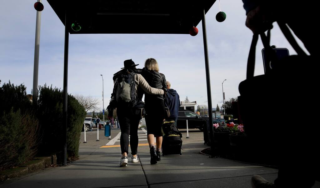 Passengers leave the Charles M. Schulz-Sonoma County Airport terminal in Santa Rosa on Tuesday, Dec. 24, 2019. (KENT PORTER/ PD)