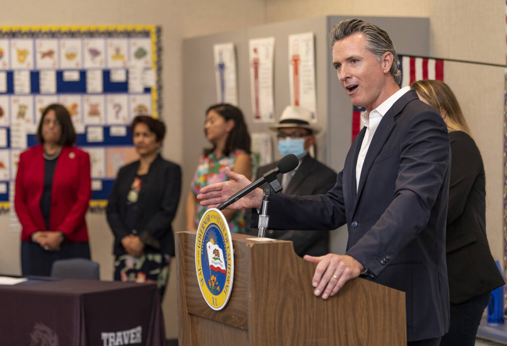 California Gov. Gavin Newsom speaks at Traver Joint Elementary School on Tuesday, July 20, 2021, in Traver, Calif. He and officials from other counties discussed the state's plan to achieve equitable statewide access to high-speed broadband internet service. The bill includes $6 billion towards broadband expansion throughout California. (Ron Holman/The Times-Delta via AP)