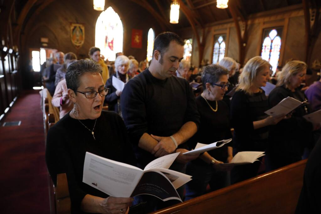 Mary Kennaugh, director of the Alleluia Choir, and her son Chris, sing during A Vigil Against Gun Violence service at Church of the Incarnation in Santa Rosa on Sunday, March 24, 2019. (BETH SCHLANKER/ The Press Democrat)