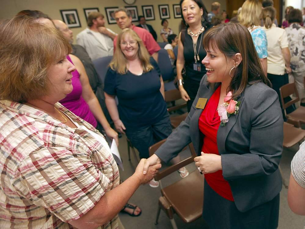 Not these days: Socorro Shiels, the Sonoma Valley Unified School District Superintendent, greets Wanda Calvert at a 2012 event in Santa Rosa. Such hands-on meetings are not possible now, as Zoom has become the room for most gatherings.