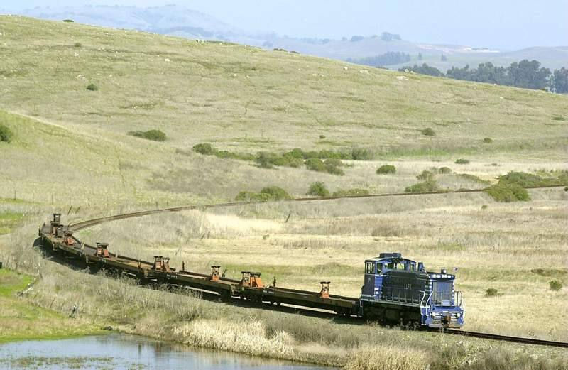 (FILE PHOTO) A freight train runs along the Northwestern Pacific Railroad line north of Highway 37 near Sears Point Raceway on Wednesday afternoon. It was the first time freight has been transported on the line since service stopped in 1998. (Christopher Chung/The Press Democrat)