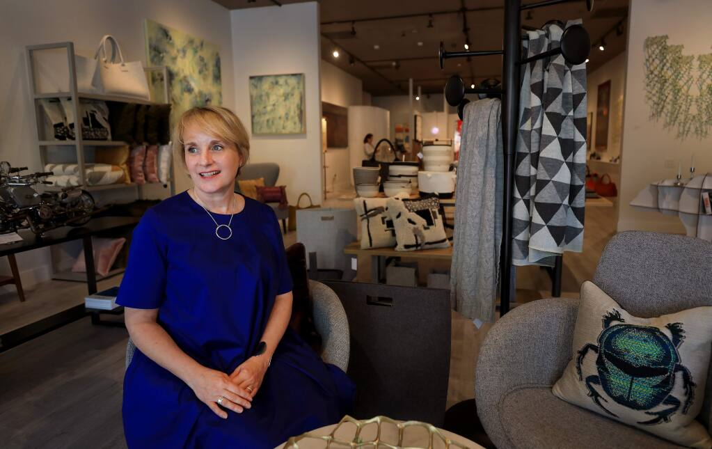 Jennifer Edwards and her recently opened business, The Passdoor, a high-end gallery store on the Sonoma Plaza, Thursday, April 25, 2019. Originally she opened the business at The Barlow but moved the business shortly before flooding damaged several business at the Sebastopol retail hub. (Kent Porter / Press Democrat)