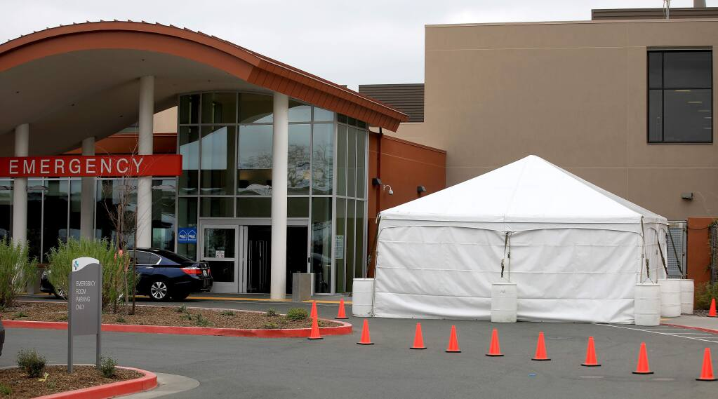 A surge tent is in the process of being outfitted to help identify those with cold, flu and coronavirus symptoms at Sutter Santa Rosa Regional Hospital, Thursday, March 5, 2020. The first Sonoma County death from coronavirus came at this hospital, on March 20. (Kent Porter / The Press Democrat) 2020