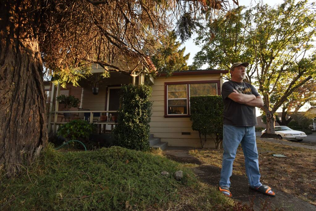 """I have a niece that lives in Petaluma if I need to leave,"" said Loren Mead, 66, who is defying the mandatory evacuation order Saturday evening and will stick it out at his home with his cat Max in Healdsburg, California. October 26, 2019.(Photo: Erik Castro/for The Press Democrat)"