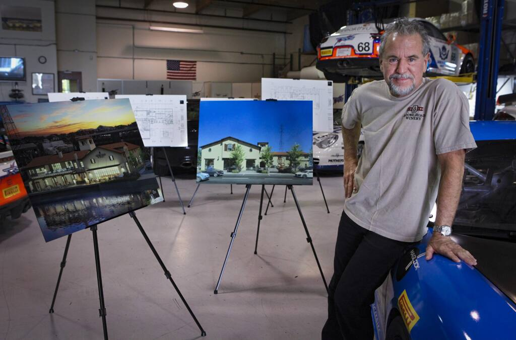 Petaluma, CA, USA. Tuesday, November 19, 2019._Kevin Buckler poses in the garage of the Adobe Winery offices where his race cars are stored and worked on. The winery is proceeding with construction on C and First Streets in downtown Petaluma, as seen in the photo renderings. (CRISSY PASCUAL/ARGUS-COURIER STAFF)