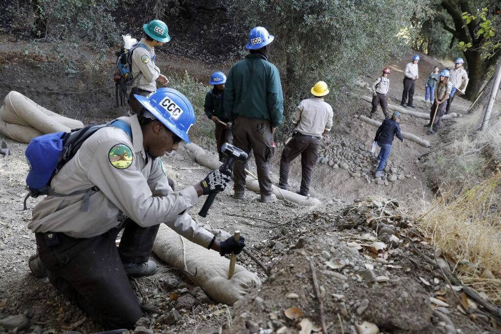 Allen Smith and other members of the Napa California Conservation Corps install wattles to combat erosion near a creek at Shiloh Ranch Regional Park in Windsor, on Wednesday, November 1, 2017. (BETH SCHLANKER/ The Press Democrat)