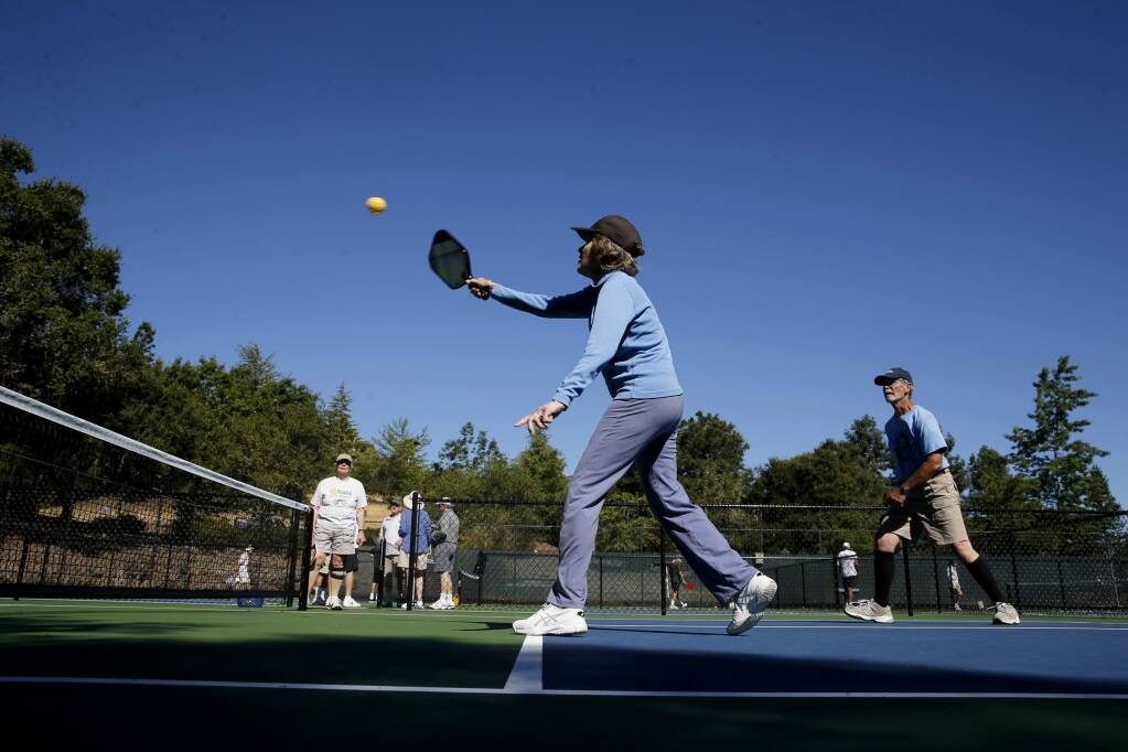 Marcia Babb and her partner Gary Bunas play pickleball on the new courts at the Oakmont East Recreation Center on Tuesday, June 12, 2018 in Santa Rosa, California . (BETH SCHLANKER/The Press Democrat)