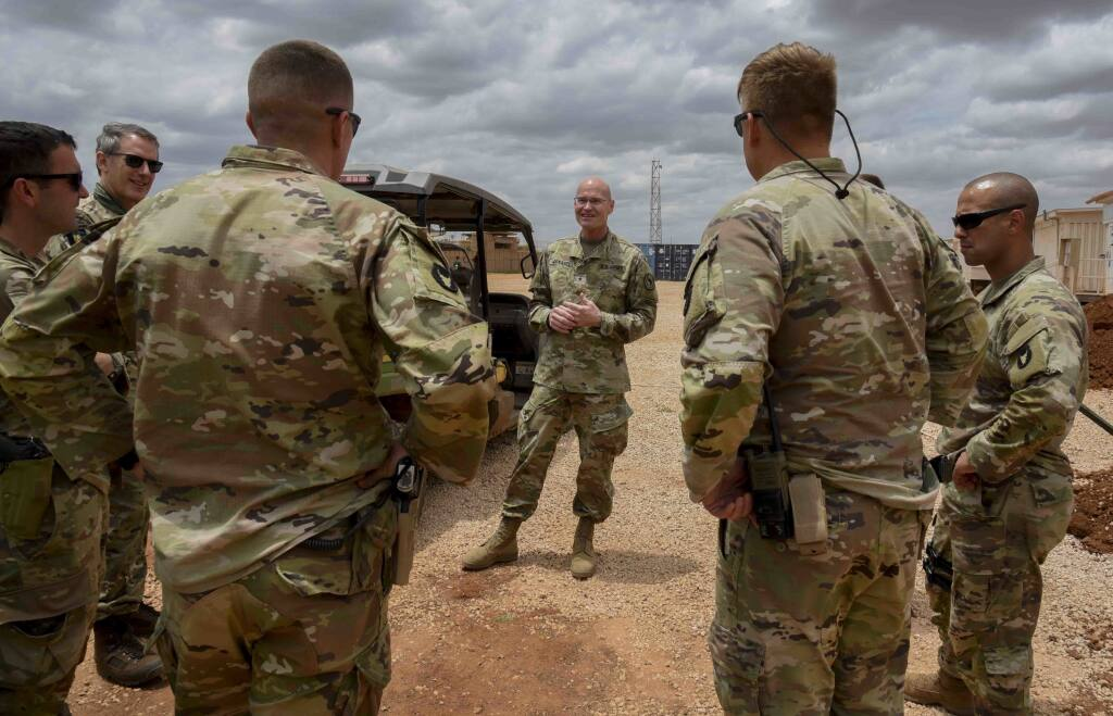 U.S. Army Brig. Gen. Damian T. Donahoe, deputy commanding general, Combined Joint Task Force - Horn of Africa, center, talks with service members during a battlefield circulation Saturday, Sept. 5, 2020, in Somalia. No country has been involved in Somalia's future as much as the United States but now the Trump administration is thinking of withdrawing the several hundred U.S. military troops from the nation at what some experts call the worst possible time. (Senior Airman Kristin Savage/Combined Joint Task Force - Horn of Africa via AP)
