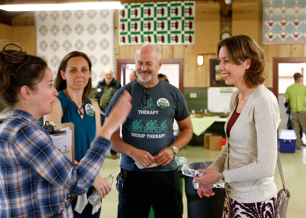 Sonoma County fifth district supervisor candidate Lynda Hopkins, right, talks with Diana Andree, left, Kate Jonasse, and Billy Coughlan before holding a town hall meeting at Sebastopol Grange, in Sebastopol, California on Wednesday, September 14, 2016. (Alvin Jornada / The Press Democrat)