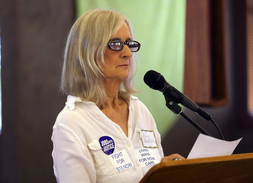In-home supportive service provider Nancy Goldstein talks about caring for her grown son after an accident left him disabled during a Workers' Rights Board Hearing in Santa Rosa on Saturday.. (JOHN BURGESS / The Press Democrat)