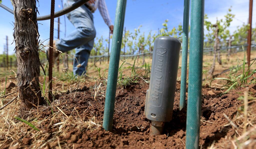 An Aqua Check probe is buried deep in the ground to monitor moisture in the soil at Benziger Family Vineyards in Glen Ellen, Friday April 24, 2015. (Kent Porter / Press Democrat) 2015