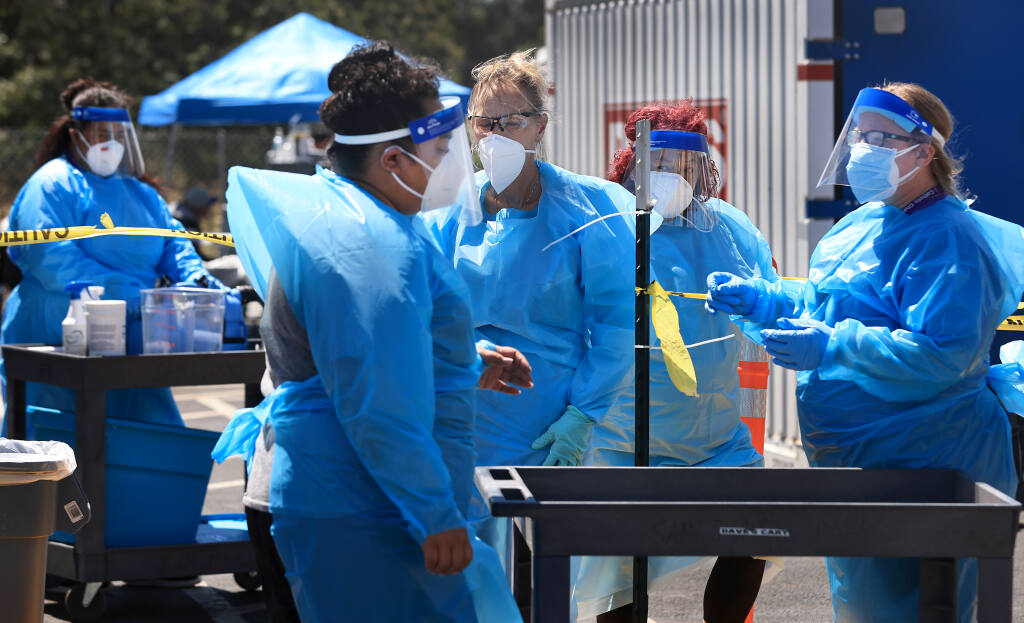 Catholic Charities staff workers prepare to clean facilities at Santa Rosa's Sam Jones Hall homeless shelter, where at least 59 cases of COVID-19 have been confirmed as of Wednesday, July 14, 2021.   (Kent Porter / The Press Democrat)