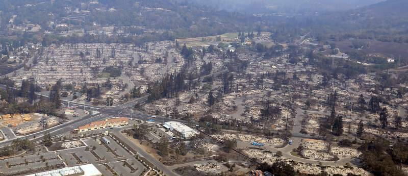 Wikiup and Larkfield, and Berry Hill Estates (bottom right), Oct. 11, three days after the Tubbs fire. (Kent Porter/The Press Democrat)