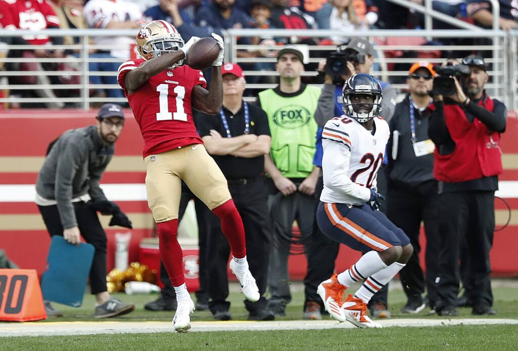 San Francisco 49ers wide receiver Marquise Goodwin catches a pass in front of Chicago Bears cornerback Prince Amukamara, right, during the first half of in Santa Clara, Sunday, Dec. 23, 2018. (AP Photo/Tony Avelar)