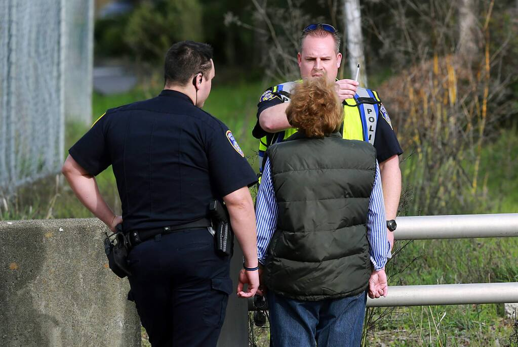 Santa Rosa police officers give a sobriety test to a 77-year-old woman who was arrested for suspected driving under the influence after she hit two pedestrians on Oakmont Drive on Wednesday, Jan. 20, 2016. (JOHN BURGESS / The Press Democrat)