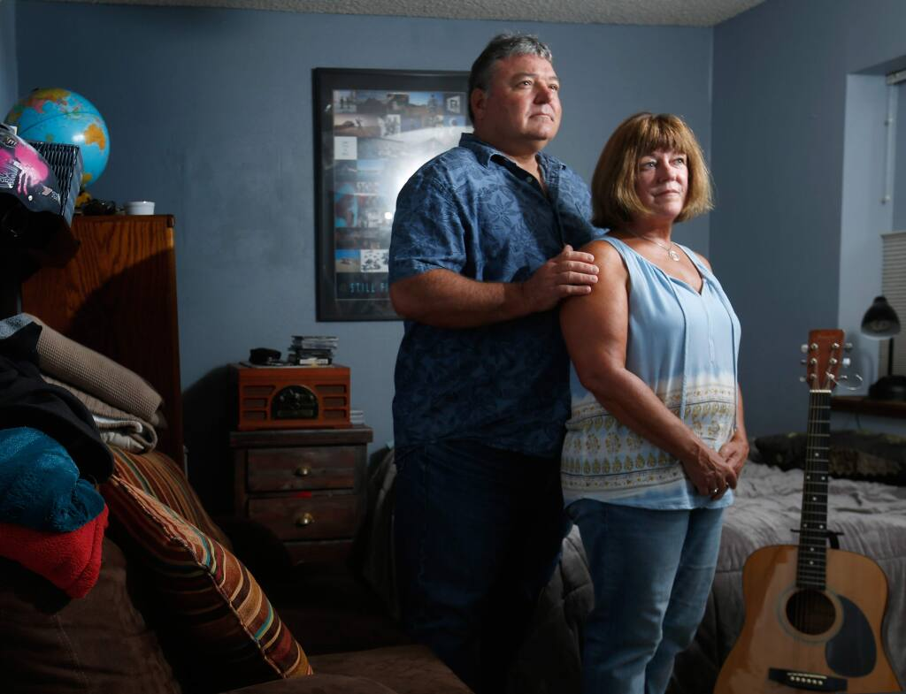 Eric and Connie Petereit pose for a portrait in their son's bedroom, at their home in Healdsburg, California on Thursday, August 24, 2017. Eric and Connie's son was diagnosed with schizophrenia in 2013, when he was 19 years old. (Alvin Jornada / The Press Democrat)
