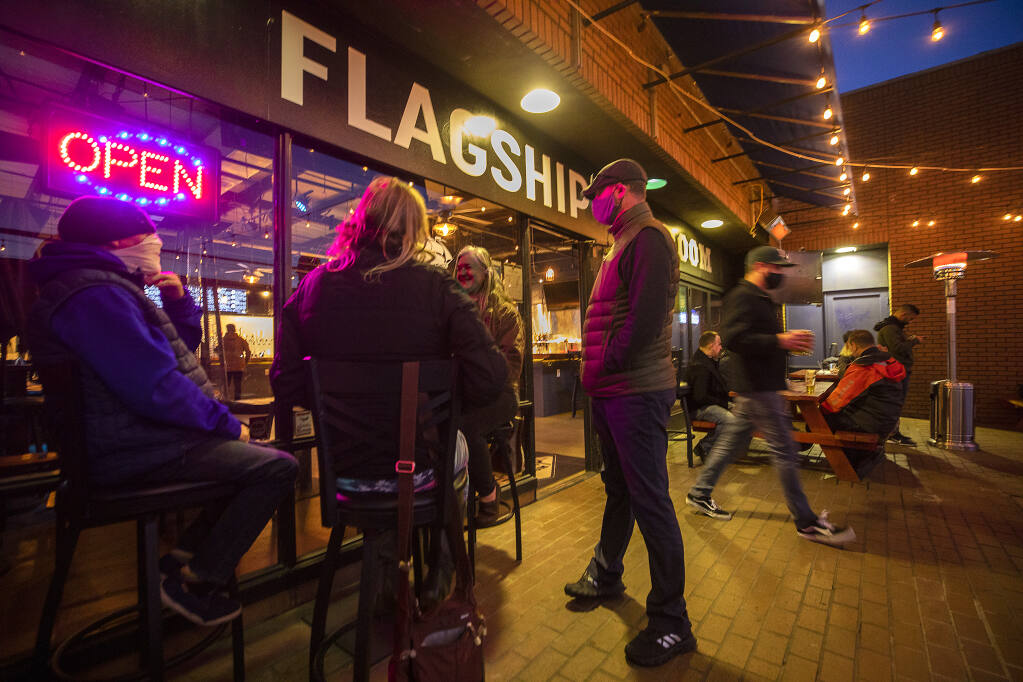 The Flagship Taproom in Santa Rosa notified customers through social media that their patio would be open for business at 2 p.m. after Gov. Newsom lifted stay-at-home orders on Monday, Jan. 25, 2021. (John Burgess / The Press Democrat)