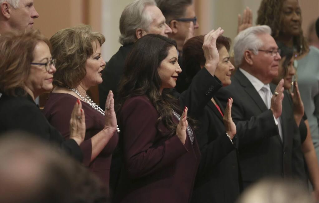 Members of the state Senate are take the oath of office, Monday, Dec. 3, 2018, in Sacramento, Calif. Seen from left, are Maria Elena Durazo, D-los Angeles, Shannon Grove, R-Bakersfield, Susan Rubio, D-Baldwin Park, Anna Caballero, D-Salinas and Bob Archuleta, D-Pico Rivera. (AP Photo/Rich Pedroncelli)