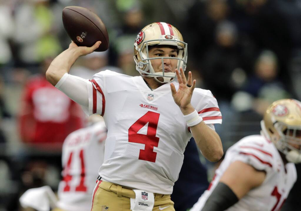 San Francisco 49ers quarterback Nick Mullens passes against the Seattle Seahawks during the first half Sunday, Dec. 2, 2018, in Seattle. (AP Photo/John Froschauer)