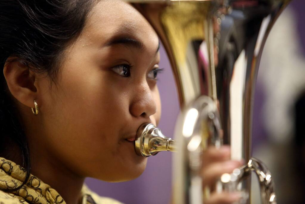 Marielle Salcedo plays the baritone during Comstock Middle School's band class, Monday, Sept. 8, 2014. (CRISTA JEREMIASON/ PD)