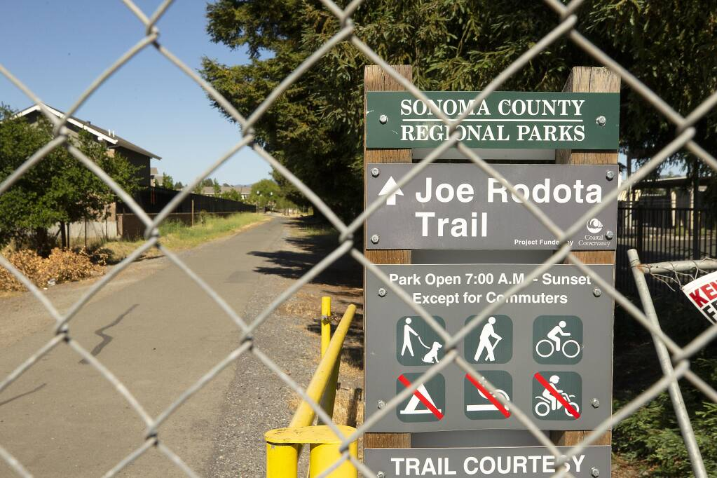 The Joe Rodota Trail in Santa Rosa remains closed after law enforcement officers cleared hundreds of homeless campers from the area around Stony Point Road at the end of January. Locked gates at Stony Point Road stop bikers, hikers and walkers from accessing the trail leading from Santa Rosa to Sebastopol.  (photo by John Burgess/The Press Democrat).