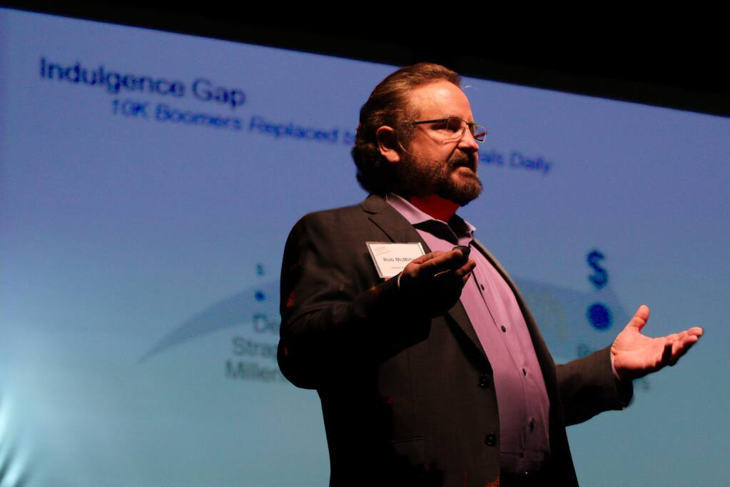 Rob McMillan, founder of Silicon Valley Bank's Premium Wine Division, speaks on wine business trends in 2018 at Sonoma County Winegrowers' Dollars & Sense Seminar and Trade Show in Santa Rosa on Jan. 11, 2018 (JEFF QUACKENBUSH / NORTH BAY BUSINESS JOURNAL)