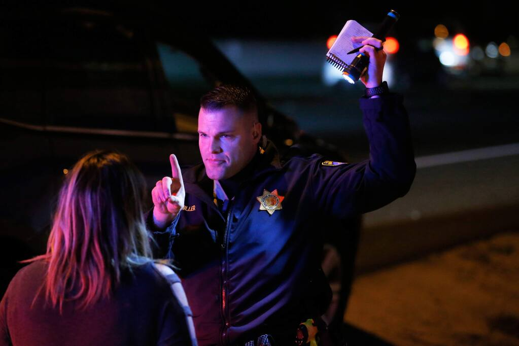 California Highway Patrol officer Josh Miller administers a field sobriety test to a driver who Miller pulled over under suspicion of driving under the influence of alcohol, on Highway 101 in Petaluma, California, on Saturday, February 24, 2018. (Alvin Jornada / The Press Democrat)