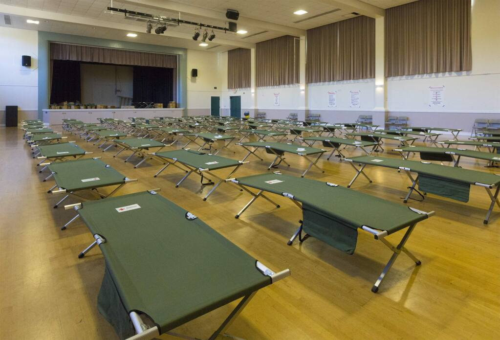 The cots were ready, the volunteers showed up, and the doors were open at the Sonoma Veterans Memorial Hall, ready for evacuees. But on Monday morning, Oct. 28, they were designated 'on hold'. (Photo by Robbi Pengelly/Index-Tribune)