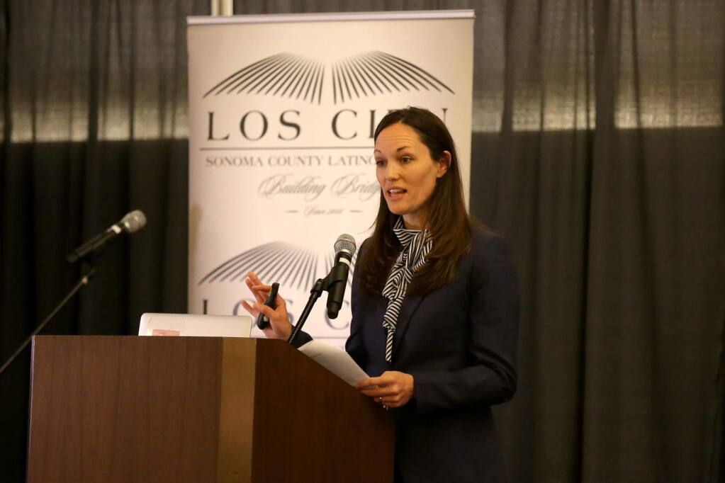 Sonoma County human services analyst Leah Murphy speaks during Los Cien's State of the Latino Community event at Sonoma State University on Sept. 26. (BETH SCHLANKER / The Press Democrat)