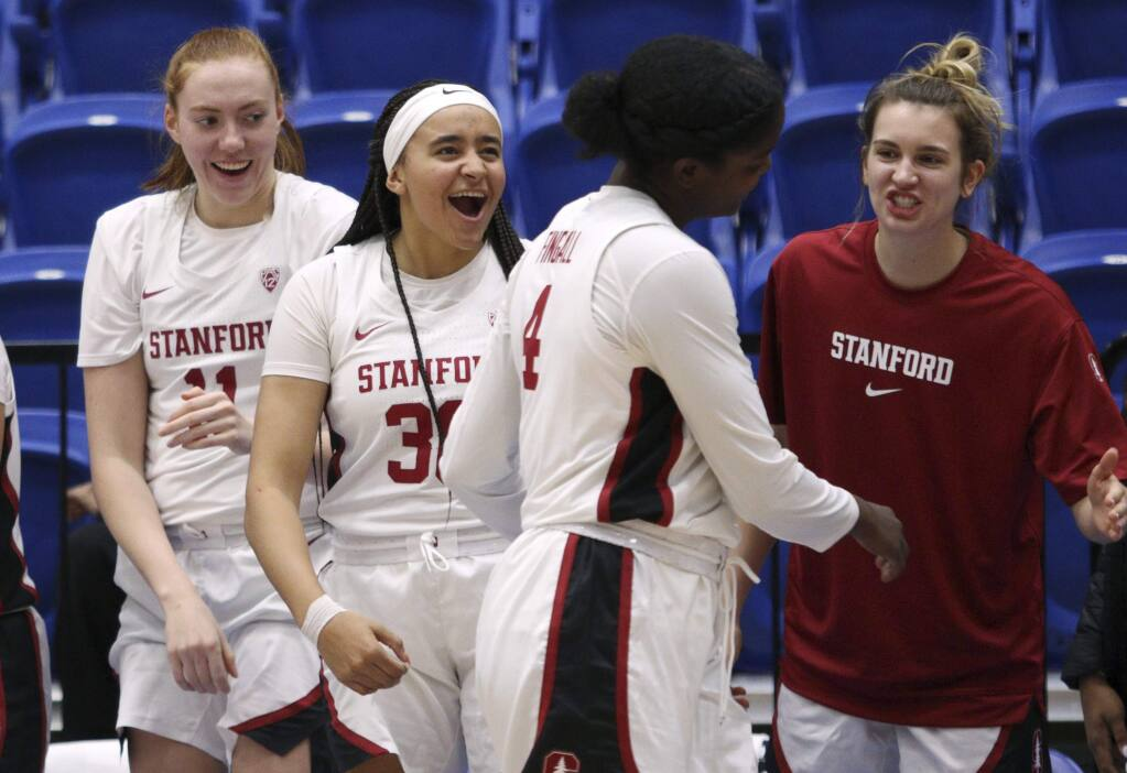Stanford players celebrate a basket by Nadia Fingall (4) during the second half against California Baptist in Victoria, British Columbia, Thursday, Nov. 28, 2019. (Chad Hipolito/The Canadian Press via AP)