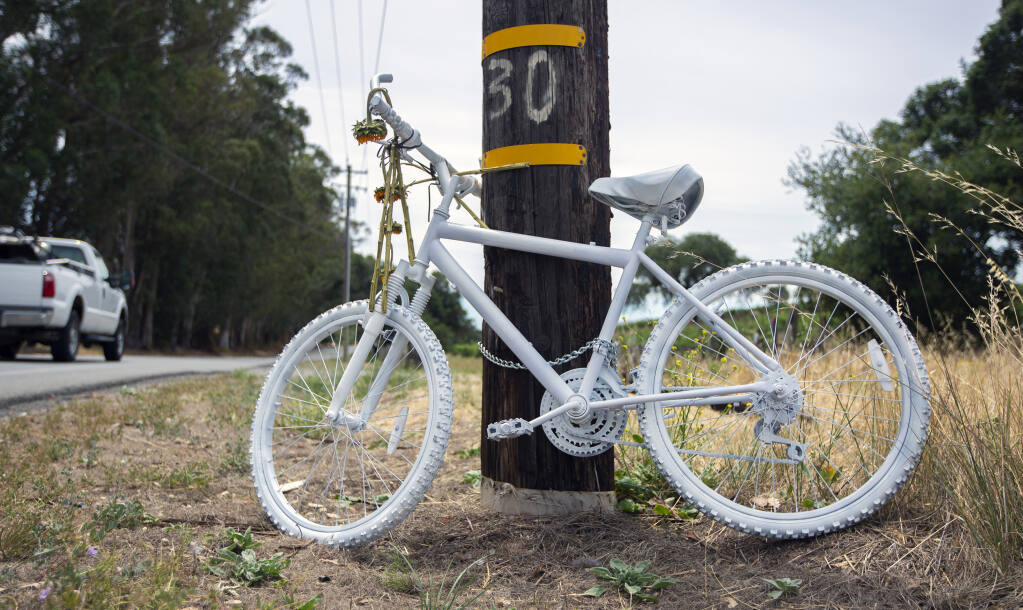 A bicycle painted white, chained to a power pole on Highway 12, where cyclist Adrian Albert was the fatal victim of a hit and run. (Photo by Robbi Pengelly/Index-Tribune)