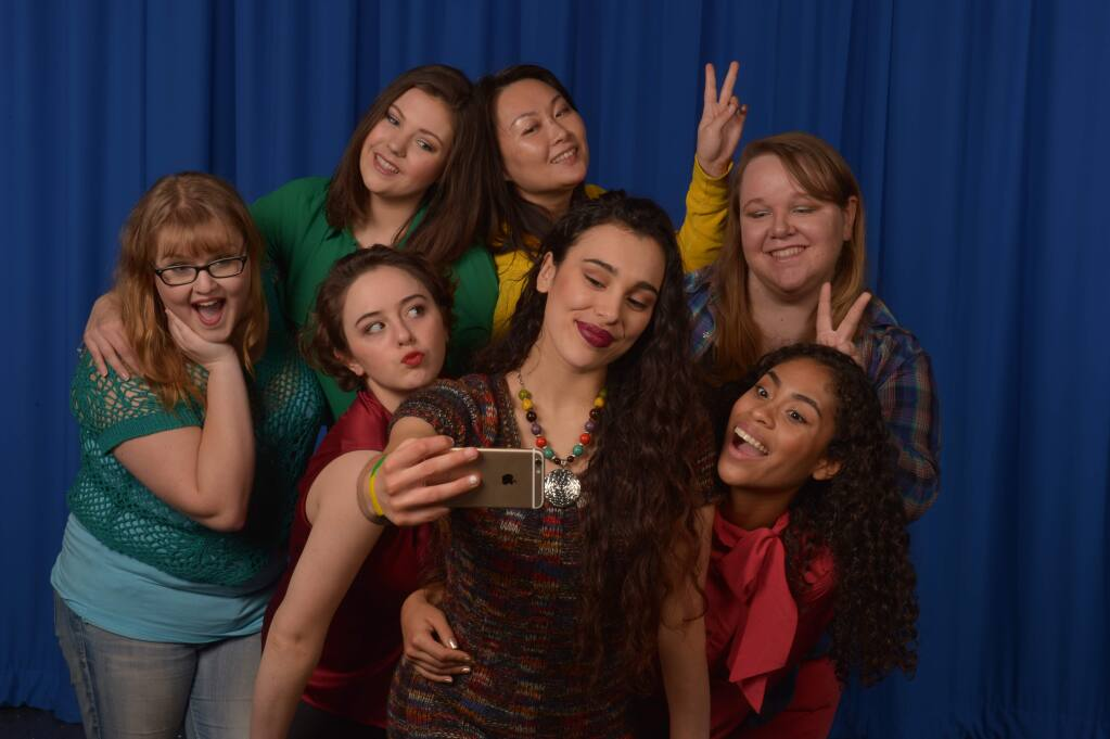 Siobhan O'Reilly, in red left of center, shines in the SJRC production of 'Emotional Creatures.'