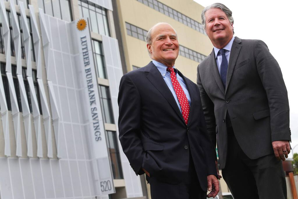 Luther Burbank Savings President and CEO John Biggs, right, and Chairman Victor Trione at the new Luther Burbank Savings headquarters in downtown Santa Rosa, on Tuesday, April 12, 2016. (Christopher Chung / The Press Democrat)