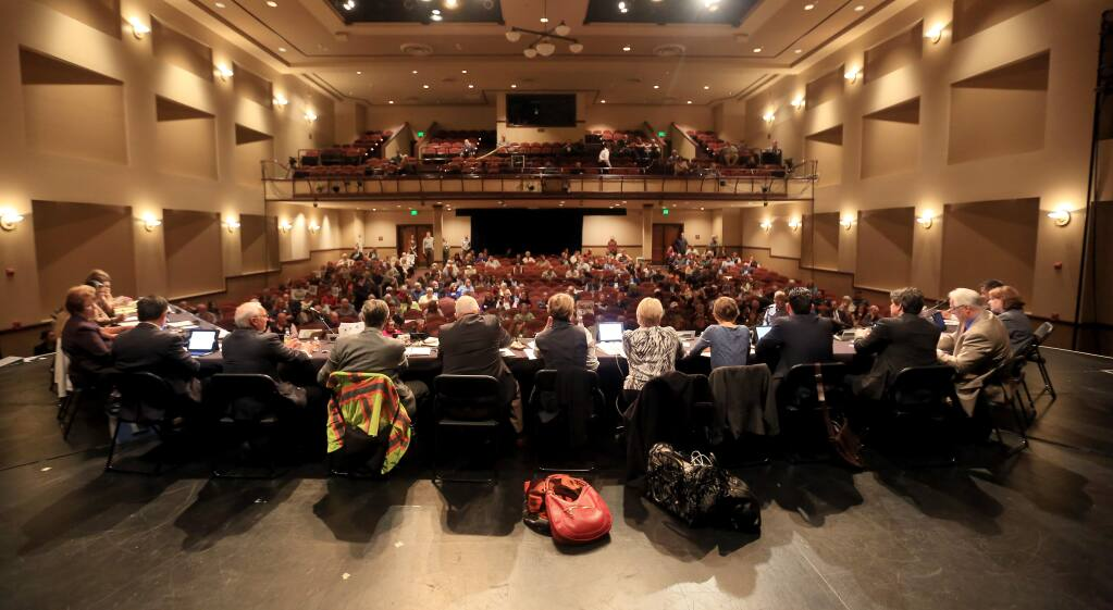 A Napa County planning commission meeting was held at the Napa County Unified School District theater in Napa, Tuesday March 10, 2015 to hold a large crowd as a discussion about a moratorium on new wineries in the Napa County is discussed. (Kent Porter / Press Democrat) 2015