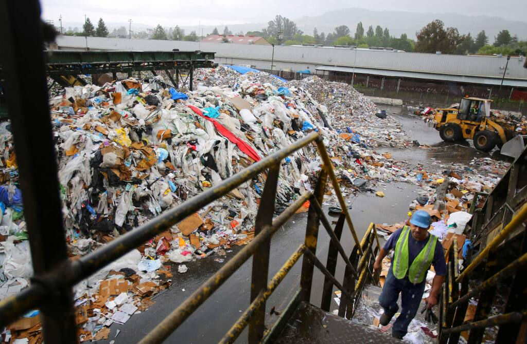 Raul Avalos walks up to the Redwood Empire Disposal's sorting line at the recycling center in Santa Rosa on Thursday, May 14, 2015. (CHRISTOPHER CHUNG/ PD)