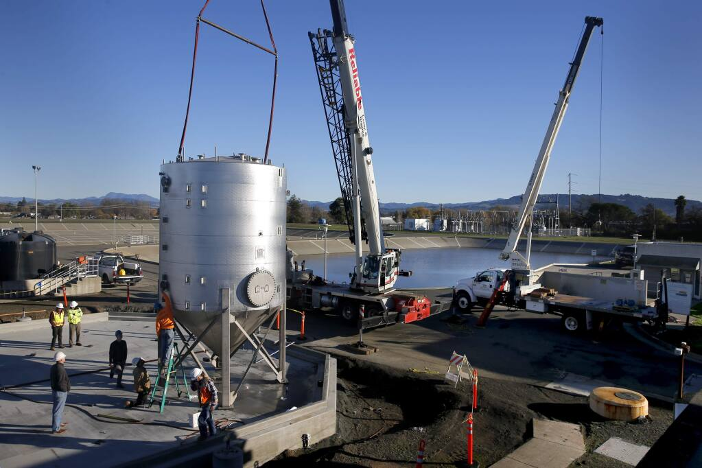 Employees from Pacific Infrastructure Corp. install a high strength waste tank at the Laguna Treatment Plant in Santa Rosa, on Tuesday, December 15, 2015. (BETH SCHLANKER/ The Press Democrat)