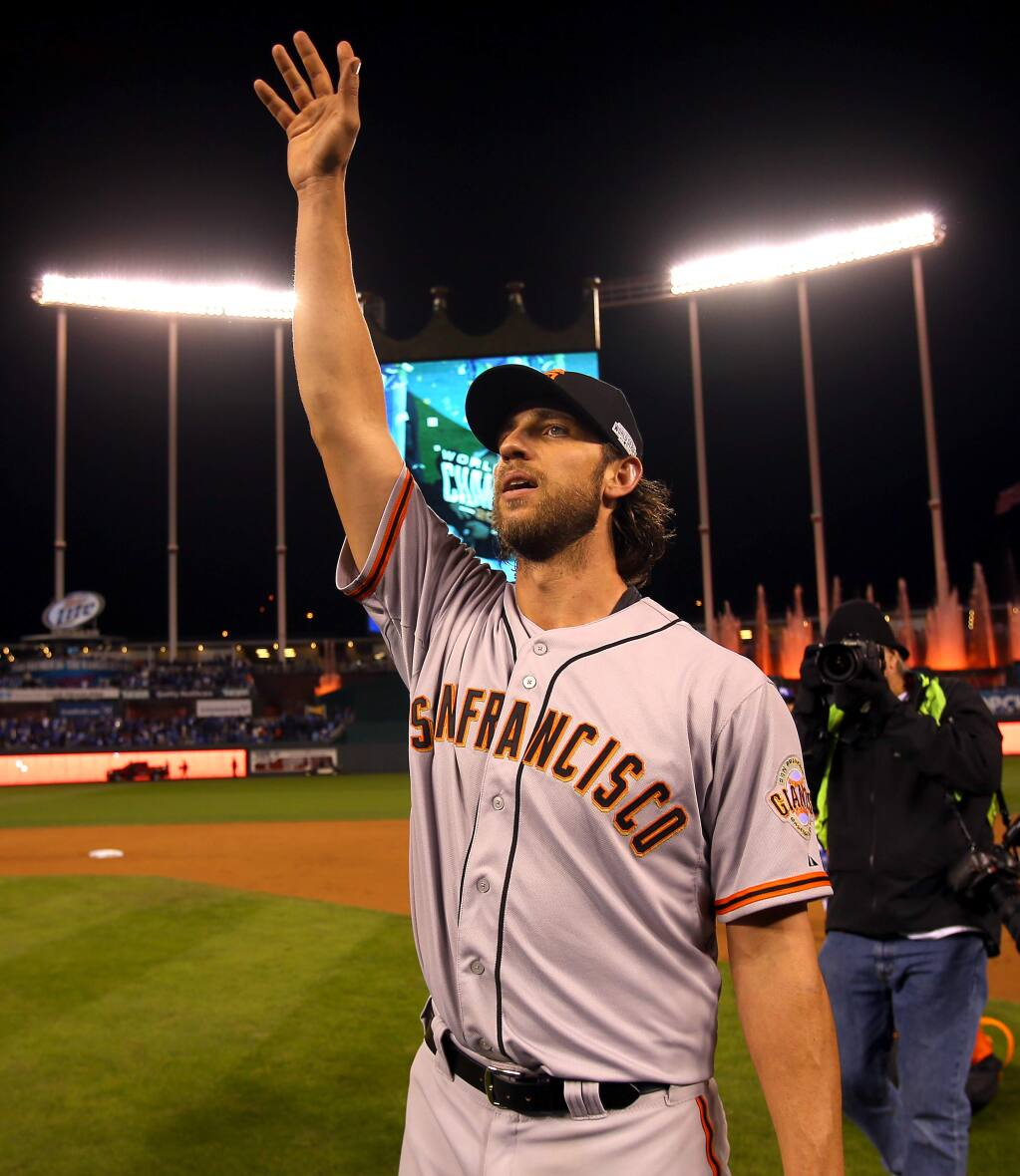 San Francisco Giants pitcher Madison Bumgarner waves to Giants fans after beating the Kansas City Royals in Game 7 of the World Series in Kansas City on Wednesday, Oct. 29, 2014. (Christopher Chung / The Press Democrat)