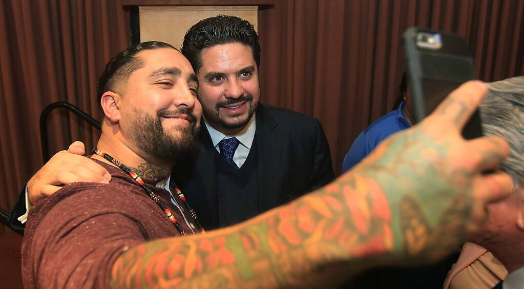City of Santa Rosa community outreach specialist Salavdor Sanchez, left, takes a photo with Mexico's Consul General Gemi Jose Gonzalez, after Gonzalez gave the keynote address during a Los Cien meeting at the Flamingo Resort and Hotel in Santa Rosa, Friday Jan. 27, 2017. (Kent Porter / The Press Democrat) 2017