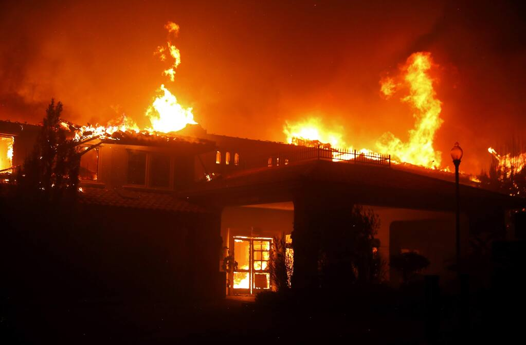 A building at Varenna at Fountaingrove is engulfed by fire in Santa Rosa on Monday, Oct. 9, 2017. (CHRISTOPHER CHUNG/ PD)