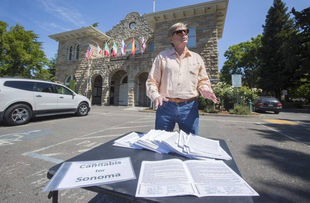 Jon Early at City Hall with the 791 signatures he collected in support of a allowing cannabis businesses within the Sonoma city limits, in June, 2018. The petition will be on the Nov. 2020 ballot, unless Earlyl himself requests its removal. (Photo by Robbi Pengelly/Index-Tribune)