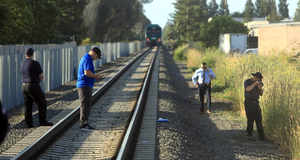 Rohnert Park Department of Public Safety officials document the scene of SMART train vs bicyclist fatality at Golf Course Drive in Rohnert Park, Friday, June 28, 2019. It is the second train fatality in as many days at the same location. (Kent Porter / The Press Democrat) 2019