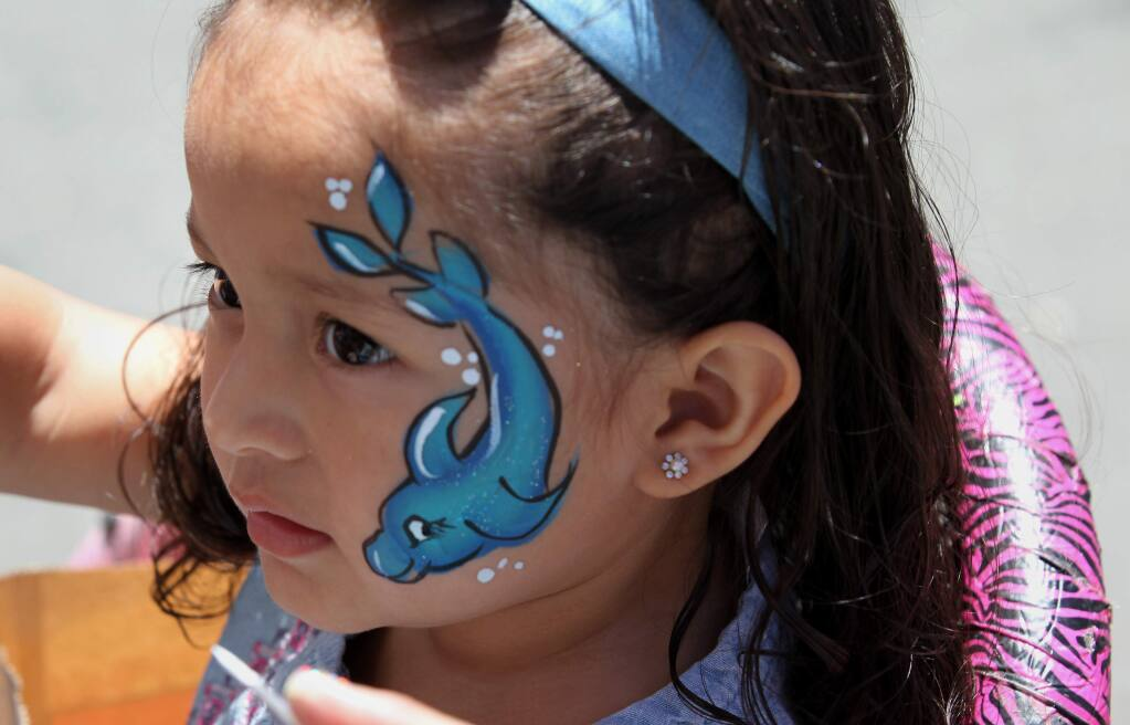 Catalina homes resident, Isabella Vera, 2, has her face painted at a Catalina Street Fair for Catalina Townhomes in Santa Rosa, Calif., on Saturday, June 3, 2017. (Photo by Darryl Bush / For The Press Democrat)