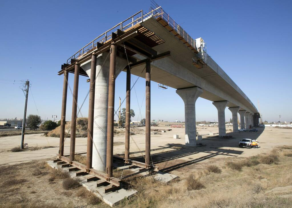 FILE - This Dec. 6, 2017 file photo shows an elevated sections of the high-speed rail under construction in Fresno, Calif. (AP Photo/Rich Pedroncelli, File)